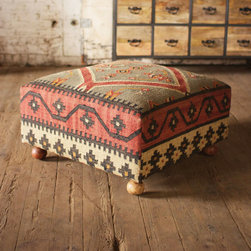 Anya Ottoman - This ottoman looks like it came straight from the souq. With its whimsical ball legs and eye-catching kilim pattern, the versatile ottoman works well as a footrest or low stool. It can even double as a coffee table when topped with a tray.