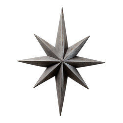 Star Wall Decoration - An heirloom fragment graces your wall with striking geometry and the radiant shape of a motif not widely used in decades, but still holding the power to geometrically define a space with a mix of the classic and the playful.  The Star Wall Decoration is over three feet high, just right to balance a door or window in your architecture or to pair with a mirror, and its wooden angles are washed in a deep, distressed lead grey for a traditional sobriety that mixes well with multiple palettes.