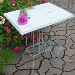 Unique Shabby Chic Side Table - Shabby chic meets industrial with this great functional accent table to add to your living room, covered porch, bedroom or foyer. Painted wrought iron magazine stand is topped off with a reclaimed oak top from a vintage Singer sewing machine cabinet. Chalk paint finish, distressed and protected with wax finish.