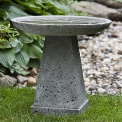 Campania International Halifax Cast Stone Bird Bath - About Campania InternationalEstablished in 1984, Campania International's reputation has been built on quality original products and service. Originally selling terra cotta planters, Campania soon began to research and develop the design and manufacture of cast stone garden planters and ornaments. Campania is also an importer and wholesaler of garden products, including polyethylene, terra cotta, glazed pottery, cast iron, and fiberglass planters as well as classic garden structures, fountains, and cast resin statuary.Campania Cast Stone: The ProcessThe creation of Campania's cast stone pieces begins and ends by hand. From the creation of an original design, making of a mold, pouring the cast stone, application of the patina to the final packing of an order, the process is both technical and artistic. As many as 30 pairs of hands are involved in the creation of each Campania piece in a labor intensive 15 step process.The process begins either with the creation of an original copyrighted design by Campania's artisans or an antique original. Antique originals will often require some restoration work, which is also done in-house by expert craftsmen. Campania's mold making department will then begin a multi-step process to create a production mold which will properly replicate the detail and texture of the original piece. Depending on its size and complexity, a mold can take as long as three months to complete. Campania creates in excess of 700 molds per year.After a mold is completed, it is moved to the production area where a team individually hand pours the liquid cast stone mixture into the mold and employs special techniques to remove air bubbles. Campania carefully monitors the PSI of every piece. PSI (pounds per square inch) measures the strength of every piece to ensure durability. The PSI of Campania pieces is currently engineered at approximately 7500 for optimum strength. Each piece is air-dried and then de-molded by hand. After an internal quality check, pieces are sent to a finishing department where seams are ground and any air holes caused by the pouring process are filled and smoothed. Pieces are then placed on a pallet for stocking in the warehouse.All Campania pieces are produced and stocked in natural cast stone. When a customer's order is placed, pieces are pulled and unless a piece is requested in natural cast stone, it is finished in a unique patinas. All patinas are applied by hand in a multi-step process; some patinas require three separate color applications. A finisher's skill in applying the patina and wiping away any excess to highlight detail requires not only technical skill, but also true artistic sensibility. Every Campania piece becomes a unique and original work of garden art as a result.After the patina is dry, the piece is then quality inspected. All pieces of a customer's order are batched and checked for completeness. A two-person packing team will then pack the order by hand into gaylord boxes on pallets. The packing material used is excelsior, a natural wood product that has no chemical additives and may be recycled as display material, repacking customer orders, mulch,or even bedding for animals. This exhaustive process ensures that Campania will remain a popular and beloved choice when it comes to garden decor.Please note this product does not ship to Pennsylvania.