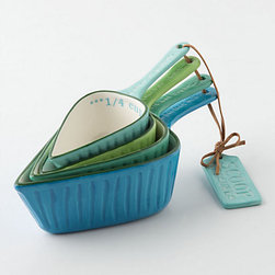 Spades Measuring Cups - The only thing I love more than aqua is aqua mixed with shades of blue and green. The shape of these measuring cups is so unique.