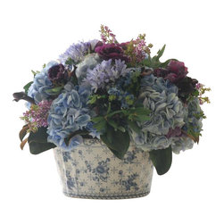 Winward Designs - Hydrangea Mix Floral In Ceramic Pot Flower Arrangement - Enjoy a fresh-from-the-garden look for years to come with this permanent arrangement of romantic flowers. The mix of hydrangeas and greenery bursting from a beautiful porcelain pot is perfect for a dining room table or coffee table. No one will have to know you didn't cut these from your garden!