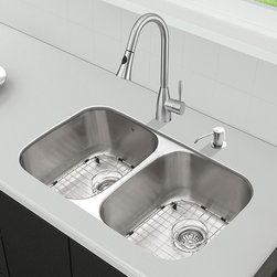 Vigo Industries - All in One 32 in. Undermount Stainless Steel - Sink is fully undercoated and padded with multi layer sound eliminating technology which also prevents condensation. All VIGO kitchen sinks warranted to never rust. Faucet features spray face that resists mineral buildup and is easy-to-clean. VIGO finishes resist corrosion and tarnishing, exceeding industry durability standards Drip-free ceramic disc cartridge. Limited Lifetime Warranty. Exterior Measures: 32 1/4 in. W x 18 1/2 in. D. Each bowl's interior dimensions: 14 5/8 in. W x 16 1/2 in. D. Bowl depth: 9 in. (larger bowl) and 5 in. (smaller bowl)Breathe new life into your kitchen with a VIGO All in One Kitchen Set featuring a 32 in. Undermount kitchen sink, faucet, soap dispenser, matching bottom grids, and strainers. The VGR3218BL double bowl sink is manufactured with 18 gauge premium 304 Series stainless steel construction with commercial grade premium satin finish. Fully undercoated and padded with a unique multi layer sound eliminating technology, which also prevents condensation. All VIGO kitchen sinks are warranted against rust. Required interior cabinet space: 35 in. Kitchen sink is cUPC and NSF-61 certified by IAPMO. All mounting hardware and cutout template provided for 1/8 in. reveal or flush installation. The VG02013ST kitchen faucet features a dual function pull-out spray head for aerated flow or powerful spray, and is made of solid brass with a stainless steel finish. Includes a spray face that resists mineral buildup and is easy-to-clean. High-quality ceramic disc cartridge. Retractable 360-degree swivel spout expandable up to 30 in. Single lever water and temperature control. All mounting hardware and hot/cold waterlines are included. Water pressure tested for industry standard, 2. 2 GPM Flow Rate. Standard US plumbing 3/8 in. connections. Faucet height: 16 in. Spout reach: 8 3/4 in. Kitchen faucet is cUPC, NSF-61, and AB1953 certified by IAPMO. Faucet is ADA Compliant. 2-hole insta