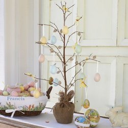 Butterfly Tree Centerpiece - I love the idea of decorating a tree with eggs for Easter! It would make a great centerpiece for your dining table.