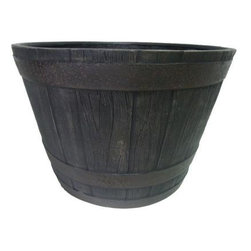 Southern Patio Whiskey Barrel Resin Planter - This wood whiskey barrel is UV resistant and equipped with plenty of drainage holes to protect plants from drowning.