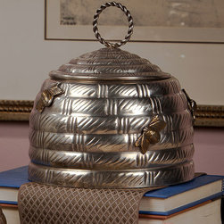Antique Silver Bee Box - Traditional motifs reinvented with the unabashed charm of transitional d�cor , the Antique Brass Bee Box is a lidded metal pot formed into the iconic domed shape of a beehive attended by a few plump worker bees that hover over the walls. The lid of the textured hive can be lifted with an airy braided-ring handle. This neat, imaginative accent is especially perfect for the nursery or the kitchen.