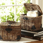"""Daytrip Lidded Split Rattan Basket, Small - Skilled craftsmanship is evident in the intricate weaving of our rattan basket, which was inspired by vintage automobile trunks. 10"""" wide x 7.75"""" deep x 10.5"""" high Made of handwoven split malacca and natural rattan. Iron sheet metal hardware with a bronze finish."""
