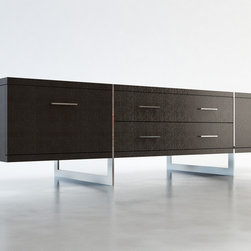 Allen Contemporary & Modern TV Stands by ModLoft - Designed to make the most of its space, the striking Allen TV entertainment unit appears to be suspended from the polished stainless steel legs which run from top to floor. Contains two center drawers (26L x 15D x 5H) for basic storage. Each side contains a standard door (interior cabinet measures 19W x 19D x 10H) to an A/V-ready compartment complete with rear ventilation/wire holes. No assembly required. Available in wenge or walnut wood finishes. Also available in white lacquer finish. Imported.