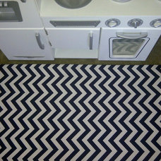 Woven area rug in a Modern and Classy Navy and White Chevron stripe in 2 ft by 3