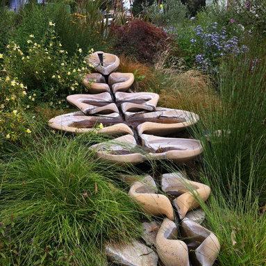 Flowforms - Closeup shot of the Sevenfold Flowform Fountain at the Ceres Community Project Garden in Sebastopol.