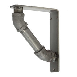 """Timeless Wrought Iron - Industrial Iron Corbel - 2"""" - 5x7 - Aged Pewter - The Industrial Iron Corbel is a decorative and functional iron bracket made from solid steel. This iron corbel measures 2"""" wide and is available in the following bracket sizes (Depth x Height x Width): 5 x 7 x 2; 6 x 8 x 2; 7 x 9 x 2; 8 x 10 x 2; 9 x 11 x 2; 10 x 12 x 2. Common uses for our Industrial Iron Corbels include granite & stone counter top supports, shelving brackets, fireplace mantel support and much more. You can choose from 4 finish options including Black; Aged Bronze; Aged Pewter; or Clear Coat (over raw metal). Want to paint this corbel yourself? Choose """"Raw Material"""" in the finish options drop-down and your corbels will arrive ready for you to paint (you will want to clean them of skin oils, dust & dirt before applying your own finish)."""