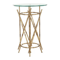 Safavieh - Maria Accent Table - Faux bois goes tropical in the Maria accent table with the sculptural texture of bamboo shoots artfully formed of iron. The warm gold patina of the table base contrasts a clear glass top for a classic look that works with myriad decorating styles.