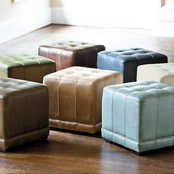 "Ballard Designs - Leather Cube Ottoman - It's a footstool. It's a chair. It's a table. No matter how you look at it, our leather cube ottoman is an incredible value. Handcrafted of solid hardwood with plush, 4"" foam tufted top and double-stitched, full grain leather. Solid maple feet with rich walnut finish. Compare ours to lesser ones sold by national retailers for hundreds more."