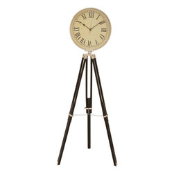 Benzara - Elegant Designed Metal Wood Clock with Ivory Hued Dial - This wonderfully crafted clock comes with a simple yet elegant design and is circular in shape with the dial and numbers within. The beautiful dial contains the hour and minute hands along with the hours displayed in roman numerals. The dark hands and numbers offer a contrasting match to the dial and ensure clear and prominent display of the time. The clock comes with a tripod stand that effectively holds and showcases the clock at the desired elevated angle. The adjustable tripod stand serves to achieve the right level at which the clock needs to be projected. The clock has an ivory hued dial that shows excellent contrast from the tripod color. Perfect to be owned or gifted to near and dear ones, this exquisitely designed clock exudes visual appeal. The clock is made of high quality metal and wood that ensure the endurance to last for a long time..
