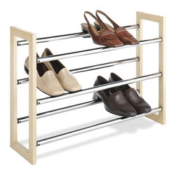 "Whitmor - Stackable Wood & Chrome Shoe Rack - This unit is sturdy and stable because of its flat base - not shaky like some similar racks. Made of solid wood and chrome bars. Three levels of shoes will easily fit underneath shirts or skirts. The bars telescope making the unit expandable. Holds up to 21 pair shoes. Requires some simple assembly.   Dimensions: 25""-46""w x 7""d x 18""h"