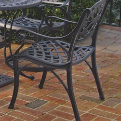 HomeStyles - Outdoor Dining Chair - Set of 2 - Set of 2. Hand antiqued powder coat finish. Sealed with a clear coat to protect finish. Nylon glides on all legs. Stainless steel hardware. Made from cast aluminum. Seat height: 15.5 in.. Overall: 22.83 in. W x 21.65 in. D x 32.68 in. H. Warranty. Assembly Instructions
