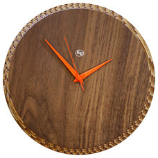 modern clocks by Curated