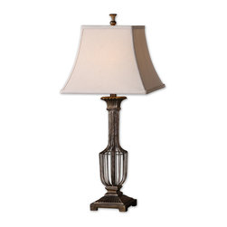 Uttermost - Anacapri Antique Gold Table Lamp - Walk through the villages of Provence and you might spot a hand-woven metal urn or basket through the kitchen window. Made in the same artisan fashion and topped with an off-white linen shade, this antiqued, gold-finished rustic lamp is ready to bring French provincial charm to your home.