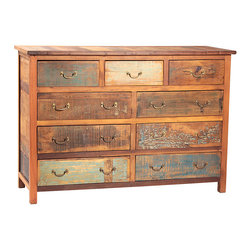 Nantucket 9 Drawer Dresser, Medium Brown - Dramatic and interesting, the Nantucket 9-drawer dresser is a rustic selection for the bedroom. This dresser delivers spacious wardrobe storage with three small drawers and six large drawers - all accented with traditional pulls. Finished in sealed medium brown, the dresser is crafted from reclaimed Indian hardwoods that have been enhanced by highly distressed paints in various tones and coverage levels. The resulting finish is an eclectic mix of colors and textures that lend visual interest and dimension to this rustic 9-drawer dresser.