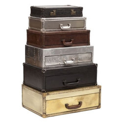 Regiment Suitcase Stack Chest - An extensive collection of case pieces styled after turn of the century steamer trunks, incorporating distressed and textured leathers, metal, and corner caps. Pieces include occasional tables, dressers, armoires, desks, and bookcases, in mottled cigar brown and black.