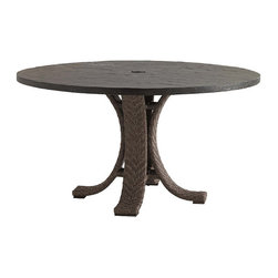 Frontgate - Blue Green Round Outdoor Dining Table, Patio Furniture - Center umbrella hole features a removable medallion bearing the Tommy Bahama monogram. Weatherstone top is hand-finished to replicate the textured look of natural slate yet is made from fiberglass and concrete for superior strength and durability, UV resistance and stain resistance. High-density polyethylene wicker offers a high tensile strength, low maintenance and resistance to UV exposure, mildew, fading, staining, stretching and cracking. All-weather wicker is easy to clean with a mild solution of soap and water. Elevate al fresco dining with contemporary warmth. The Blue Olive Round Dining Table combines a rich Weatherstone tabletop, which mimics the luxurious look of natural slate, with a pedestal base wrapped in a hand-woven channeled herringbone design of slate-gray wicker. With four curving legs, it offers ample leg space for diners and provides sleek stability for the tabletop.  .  .  .  .