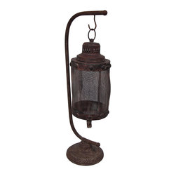 Zeckos - Rustic Hanging Hurricane Style Metal Candle Lantern with Stand - With its rustic elegance, this candle lantern will lend its vintage charm to your family room, porch, patio or garden. This decorative 27.5 inch high, 9 inch long, 6.5 inch wide (70 x 23 x 17 cm) candle lantern features a 8.5 inch high, 6.5 diameter (22 x 17) metal mesh globe that accepts up to 3 inch diameter candles (not included) by opening the swing clasp closure and lifting the top. The globe hangs from a metal stand, and boasts a faux rusted finish. With this free-standing lantern, you can softly light the night wherever you are It's perfect to add mood lighting while entertaining, or to accent your entryway It's wonderful as a housewarming gift sure to be loved
