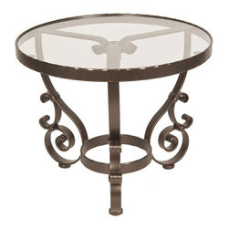 O.W. Lee - O.W. Lee San Cristobal 24 in. Round End Table - OWLC354 - Shop for Tables from Hayneedle.com! If we're known by the company we keep then the patio chair or loveseat that finds itself located next to the O.W. Lee San Cristobal 24 in. Round End Table is about to get a serious upward bump in their street cred. This classically styled table features a wrought iron base that sports ornate and engaging curls with a powder-coat finish in your choice of colors. The top is available in your choice of colors and is smooth and easy-to-maintain surface.Materials and construction: Only the highest quality materials are used in the production of O.W. Lee Company's furniture. Carbon steel galvanized steel and 6061 alloy aluminum is meticulously chosen for superior strength as well as rust and corrosion resistance. All materials are individually measured and precision cut to ensure a smooth and accurate fit. Steel and aluminum pieces are bent into perfect shapes then hand-forged with a hammer and anvil a process unchanged since blacksmiths in the middle ages. For the optimum strength of each piece a full-circumference weld is applied wherever metal components intersect. This type of weld works to eliminate the possibility of moisture making its way into tube interiors or in a crevasse. The full-circumference weld guards against rust and corrosion. Finally all welds are ground and sanded to create a seamless transition from one component to another. Each frame is blasted with tiny steel particles to remove dirt and oil from the manufacturing process which is then followed by a 5-step wash and chemical treatment resulting in the best possible surface for the final finish. A hand-applied zinc-rich epoxy primer is used to create a protective undercoat against oxidation. This prohibits rust from spreading and helps protect the final finish. Finally a durable polyurethane top coating is hand-applied and oven-cured to ensure a long lasting finish. About O.W. Lee Company An Amer