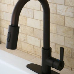 None - Modern Single Handle Oil Rubbed Bronze Faucet with Pull-Down Spout - Turn an outdated sink into a focal point with this dramatic oil-rubbed bronze faucet. The gooseneck spout makes cleaning up easy,while the attached sprayer is perfect for cleaning larger pots and pans,and it features a bold dark finish.