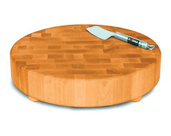 Catskill Craftsman - Catskill Craftsmen Round Slab End Grain Chopping Block - Chop, slice, and dice on this wooden circular chopping block. This block is perfect for staying on the counter top and features end grain wood design and an oil finish. The composition conveniently wont dull knives and boasts a non-slip bottom.