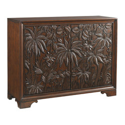 Lexington - Lexington Landara Balboa Carved Door Chest 545-973 - Inspired by the distinctive spirit of luxurious destination travel, this stunning piece offers refined detailing in it's most sophisticated form. Intricate door carvings, influences by indigenous cultures, evoke a sense of adventure and curiosity as your eyes explore the lush jungle scene filled with delightful details. Behind the magnificently doors are eight adjustable shelves and two drawers for ample storage.