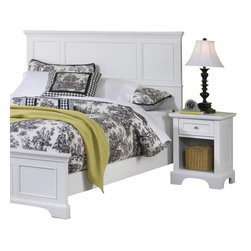 Home Styles - Home Styles Naples Queen Panel Headboard 2 Piece Bedroom Set in White Finish - Home Styles - Bedroom Sets - 55305011 - The Naples Queen Panel Headboard Two Piece Bedroom Set has solid hardwood and engineered wood construction in a rich multi-step white finish. This bedroom set includes a Queen size panel headboard and a nightstand. The panel headboard features clean straight lines and raised panels. The nightstand features one drawer and a lower open storage compartment for keep all your bed time necessities within arms reach. With contemporary design elements the Naples Queen Panel Headboard Two Piece Bedroom Set offers a lasting appeal you will enjoy for many years.The Naples Collection by Home Styles Furniture offers simple yet functional pieces for your home. It features a classic white finish that can blend in with any decor and bracket bases for that added contemporary charm. The Home Styles Furniture Naples Collection appears to be simple in design but it is in the details that give it an exquisite appeal.Includes: