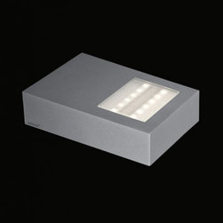 "Nimbus - Nimbus Whisky Pur LED wall light - The Whisky Pur LED wall light was designed and made by Nimbus in Germany. This modern LED fixture is an efficient and elegant outdoor lamp which can be a solution to accentuate facades or paths around buildings. The light output of the Whisky Pur LED is distributed 60% as direct beam and 40% as indirect beam. The fixture has an elegant cast aluminium, titanium grey powder coating housing. Multiples conic identations, ultra-modern LED provide a total power of 9 watts integrated in the luminaire and spread a light output which is equivalent to the power of a 50 watts halogen bulb. The lamp is available in color temperatures of 2700 Kelvin (extra - warm white) 3000K (warm white) and 4000 Kelvin (neutral white). Converter included in the package.         Product Details: The Whisky Pur LED wall light was designed  and made by Nimbus in Germany. This modern LED  fixture is an efficient and  elegant outdoor lamp which can be a solution to accentuate facades or paths around buildings. The light output of the Whisky Pur LED is  distributed 60%  as direct beam and 40% as indirect beam.  The fixture has an elegant cast aluminium, titanium grey powder coating housing. Multiples conic identations, ultra-modern LED provide a total power of 9 watts integrated in the luminaire and spread a light output which is  equivalent to the power of a 50 watts halogen bulb. The lamp is available in color temperatures of 2700 Kelvin (extra - warm white) 3000K (warm white) and 4000 Kelvin (neutral white).   Converter included in the package. Details:                         Manufacturer:            NIMBUS                            Designer:            Nimbus                            Made in:            Germany                            Dimensions:                        Width: 5.1""(130mm) X Length: 7.5""(190mm) X Depth: 2""(50mm)                                         Light bulb:                        1x9W build-in LED                                         Material:            Aluminium"