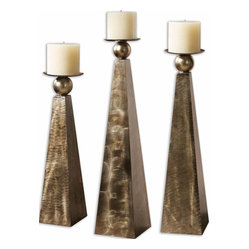 Uttermost - Cesano Bronze Candleholders, Set/3 - The clean, geometric lines of these candleholders are offset by the detailed, heavily antiqued finish. Their exquisite beauty makes them look as though they may once have belonged to an Egyptian Queen.