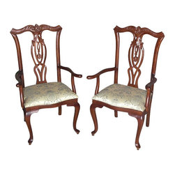MBW Furniture - Pair of 2 Mahogany Queen Anne Floral Dining Arm Chairs - his is a gorgeous pair of 2 mahogany Queen Anne style floral dining arm chairs. Their backs have very attractive carved top rails with foliage and scrolls and they feature gorgeous pierced splats with distinguished curved designs. The arm chairs have elegant carved arms and comfortable seats upholstered with a beautiful sage fabric adorned with lovely floral & instrument designs. The cabriole legs exemplify elegance. Whether added to an existing piece of furniture or standing alone these chairs would be a lovely addition to any home. These chairs are showroom models and may have some minor imperfections but as shown they are in very good condition. They are shipped assembled.