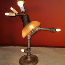 Dame Margot - An entertaining reuse of a Victorian lamp shade, a recycled floor lamp, sconce arms and pipe fittings. Approx 23H x 18W inches.