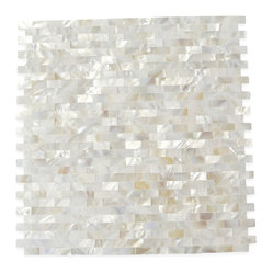 "Serene White Bricks Pearls Glass Pattern Tile - Serene White Bricks Pearls Pattern Glass Tile This captivating mother of pearl tile in white is artifully arranged in a seamless brick pattern. The pearl shell will add a durability and lasting exquisitness to your kitchen, or fireplace installation. These tiles are mesh mounted and will bring a sleek and contemporary clean design to any room. This tile in particular does not require grout. Chip Size: 10mm x 20mm Color: White Material: Pearl Shell Glass Finish: Polished Sold by the Sheet - each sheet measures 12"" x 12"" (1 sq. ft.) Thickness: 2 mm Please note each lot will vary from the next. This tile is not recommended to be installed in a shower, shower floor or pools."