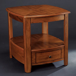 """Hammary - Primo Rectangular Drawer End Table in Warm Medium Brown Finish - """"In this hectic workaday world, with the demands of jobs and school and the endless obligations of life, sometimes it's refreshing to come home. And take a breath. And relax. And spend time with those you love, in a place you love. With Hammary's new """"""""Primo"""""""" collection, you will feel more at home than ever before. This refined collection of occasional tables, designed in the transitional/casual style, is crafted from cathedral oak veneers with bold curved shapes, creating a soothing presence in any room. Table tops and shelves also are cathedral oak veneer and feature a reverse diamond pattern. The warm, hand-rubbed medium brown finish with soft burnished detailing along the edges adds an extra touch of understated style. We built each piece in """"""""Primo"""""""" with today's active families in mind. Case in point: the cocktail table has a lift top with remote control storage under the lift top, a shelf and an extra-wide storage drawer. Other tables are equally as functional, with a wide array of storage drawers and shelves. An entertainment console tops off an already impressive group of home furnishings. Choose """"""""Primo"""""""" from Hammary for your home. It's a choice for quality craftsmanship and first-rate design. After all, you and your family deserve the very best."""