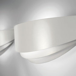 AXO Light - AXO Light   Uriel G Wall Sconce - Design by Manuel Vivian, 2011.The Uriel G Wall Sconce features curved metal, varnished in pearl white, bronze or available with chrome finishing.ADA Compliant.