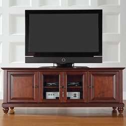 Crosley - Crosley Cambridge 60 in. Low Profile TV Stand - Vintage Mahogany Brown - KF10005 - Shop for Visual Centers and Stands from Hayneedle.com! The Crosley Cambridge 60 in. Low Profile TV Stand - Vintage Mahogany blends traditional style with modern functionality. This lower profile entertainment cabinet accommodates most 60-inch flat panel screens and is sized to complement today's homes. It is crafted of hardwood and veneers with a hand rubbed multi-step vintage mahogany finish and antique brass hardware for a touch of shine. Three adjustable shelves offer ample and versatile storage. Two raised panel doors conceal stacks of DVDs games and media components while tempered glass doors protect electronic components from dust and allow remote control access. This TV console even has a cord management feature to tame the unsightly mess of tangled wires. A beautiful way to store and display your TV and electronic components.Additional Features:Accommodates up to a 60-inch flat panel TV3 adjustable shelves give 6 levels of protected storageDual tempered glass doors allow remote control access2 side cupboards with raised panel doors and 1 adjustable shelf eachCord management featureAbout Crosley FurnitureIn 1920 Powel Crosley founded the company that pioneered radio broadcasting and mass market manufacturing around the world starting with a simple radio meticulously crafted with obsessive detail and accuracy and a measure of consideration for the wallet. These high ideals have served the company well for over 90 years and they live on in the newest addition to the family. Crosley Furniture sets a new standard for innovation function and meticulous craftsmanship in the manufacture of value-priced furniture. They proudly offer durable furniture products featuring hardwood and veneer construction with rich multi-step finishes in a multitude of styles.