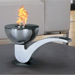 Pipe Tabletop Bio Ethanol Fireplace by PureFlame - Pipe, with a styling that recalls just that, is ideal for creating emotional decor. Providing a 360 degree, open view of the dancing flame, Pipe provides comforting warmth in a small space or patio. This fireplace offers an eco-friendly flame that is odorless. Bio Ethanol, an alternative fuel source produced from plants, only emits water vapor and carbon dioxide into the air. Although ethanol fireplaces aren't intended for use as a primary heat source, the Pipe model produces heat that will change the ambient temperature of a small area. An unobstructed view is offered through the open flame of this piece, and it may not be suitable for use in the proximity of children. Appropriate for any living space, Pipe is offered in brushed stainless steel.