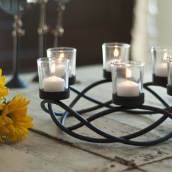 None - Round Waves Black Wroght Iron Candleholder/ Centerpiece - Accent your indoor or outdoor table with this round candle holder centerpiece. A black wrought-iron base perfectly complements the six votive candle glasses, giving your table an eye-catching center display that adds a delicate glow for festive events.