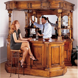Design Toscano - Toscano Tewkesbury Inn Pub - AF35056 - Shop for Bars and Bar Sets from Hayneedle.com! Shake up some good times in your very own home bar with the Toscano Tewkesbury Inn Pub. This stately item features a front and back bar complete with top canopy and six support columns. It includes beveled glass mirrors and shelves on the back bar to display all your top-shelf bottles. Drawers and cabinetry with brass hardware keep mixers and accessories neat and organized. Stem holders showcase your martini or wine glasses in style.This handsome pub is scaled to fit your room and is a replica of the Tewkesbury Inn. It's crafted from solid pine and finished in a distressed honey stain that adds to its authentic look. About Design Toscano:Design Toscano is the country's premier source for statues and other historical and antique replicas which are available through the company's catalog and website. Design Toscano's founders Michael and Marilyn Stopka created Design Toscano in 1990. While on a trip to Paris the Stopkas first saw the marvelous carvings of gargoyles and water spouts at the Notre Dame Cathedral. Inspired by the beauty and mystery of these pieces they decided to introduce the world of medieval gargoyles to America in 1993. On a later trip to Albi France the Stopkas had the pleasure of being exposed to the world of Jacquard tapestries that they added quickly to the growing catalog. Since then the company's product line has grown to include Egyptian Medieval and other period pieces that are now among the current favorites of Design Toscano customers along with an extensive collection of garden fountains statuary authentic canvas replicas of oil painting masterpieces and other antique art reproductions. At Design Toscano attention to detail is important. Travel directly to the source for all historical replicas ensures brilliant design.