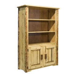 "Montana Woodworks - Montana Woodworks Bookcase in Glacier Country - This handcrafted, rustic style bookcase is sure to stand out in any room. The 14"" deep main shelves have plenty of room for books, collectables and family heirlooms. Two raised panel doors conceal a large (20"" x 30"") storage area. Finished in the ""Glacier Country"" collection style for a truly unique, one-of-a-kind look reminiscent of the Grand Lodges of the Rockies, circa 1900. First we remove the outer bark while leaving the inner, cambium layer intact for texture and contrast. Then the finish is completed in an eight step, professional spraying process that applies stain and lacquer for a beautiful, long lasting finish. Comes fully assembled. 20-year limited warranty included at no additional charge."