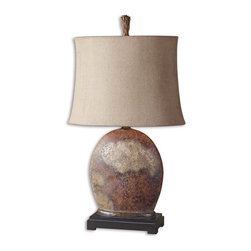Uttermost - Yunu Distressed Table Lamp - Heavily distressed rusty brown with aged ivory details and burnished accents. The oval semi drum shade is oatmeal linen textile with natural slubbing.