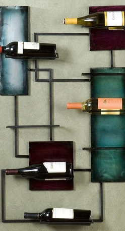 Home Decorators Collection - Wine Storage Wall Sculpture - Enjoy a wine rack that grows more stylish with each bottle of wine you store. The Wine Storage Wall Sculpture will show off your wine collection in a unique setting that provides both easy access and eye-catching appeal. Don't let limited living space keep you from displaying your love for good wine and contemporary home decor. Holds up to 8 bottles of wine. Expertly crafted to ensure lasting beauty.