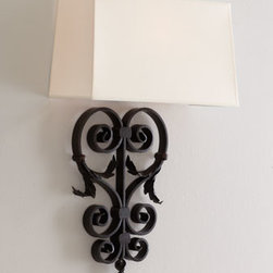 "Horchow - Aged-Iron Wall Sconce - Large wrought iron scrolls mix well with delicately curling leaves on the body of this modern wall sconce. Handcrafted of iron. Uses one 100-watt bulb. 14""W x 6.5""D x 22.75""T. Imported."