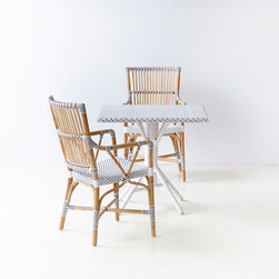 Affäire - Monique arm chair and Nicole cafe table - The Affäire collection is made of rattan and synthetic fibre. The frames are made of rattan and the woven seats, backs and the bindings are alle made of Polystrand synthetic fiber.