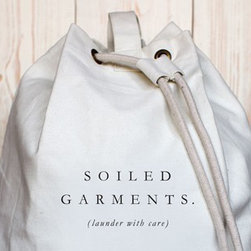 Soilded Garments, Canvas Laundry Bag - It's a dog-eat-dog world out there, and we know what it's like to get your elbows dirty. That's why we created a laundry bag. Now you can at least contain the mess in your closet, keeping all those unmentionables out of sight and out of mind. Inspired from vintage naval aesthetics, these bags are constructed from a heavy-duty cotton/poly canvas and are large enough to manage heavy loads. The reinforced stitched handle and adjustable shoulder strap allow for easy handling to the laundry room or cleaners and double their function as a perfect gym bag, boat tote, or everyday duffel. Thick rope laced through reinforced brass rings at the top of each bag keeps your clothes bundled tight, meaning no more missing socks. The high-quality construction of Izola's laundry bags is undeniable, but what really sets them apart is their detail. They come in four different design themes and attached to each bag is a list of tips for the perfect wash. With instructions this simple, guys will no longer need to worry about shrinking sweaters or bleeding brights. This bag may just be the motivator you need to wash those towels that have been hanging in the bathroom for weeks.