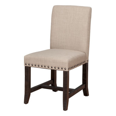 Modus Furniture International - Yosemite Upholstered Dining Chair (set of 2) - The Yosemite dining collection recreates the improvised, utilitarian look of early 20th century factory furniture. Rough-hewn planks crafted entirely from solid pine bear the characteristic saw marks, dents, pits, and random knots of logs milled on the steam-powered circular and sash saws of the era. A rustic black pine finish balances transparency and opacity to showcase these natural imperfections.  Exposed bolts, hammered metal pulls and cross-braces evoke the ingenuity and earnestness that characterized the turn of the century.