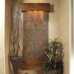 """Frontgate - Greeley Falls Gray Waterfall - 100% natural slate stone in unique, neutral colors. Copper framing of the water feature is crafted with precise metal fabrication. Smooth-flowing water distribution system will not clog or spray. Adjustable """"pebble beach"""" tray rests over water pan to eliminate backsplash. Easily serviced pump is padded to quiet vibrations. Incorporate the sights and sounds of nature into your indoor environment with our Greeley Falls Copper & Slate WaterFall. A unique and bold presence at home or work, the beauty and tranquility of gently flowing water naturally reduces stress and anxiety. Wall fountains also function as elegant wall decor.100% natural slate stone in unique, neutral colors. . . Adjustable """"pebble beach"""" tray rests over water pan to eliminate backsplash. . Conveniently located light and water flow switch. Dimmer switch adjusts light intensity. Polypropylene water pan liner prevents deterioration. Due to the individuality of the stone, each slate piece will arrive with unique colorations. View additional product specifications. Designed and hand-crafted with precision and care in the USA. Waterfall must be mounted into wall studs; hanging hardware included."""